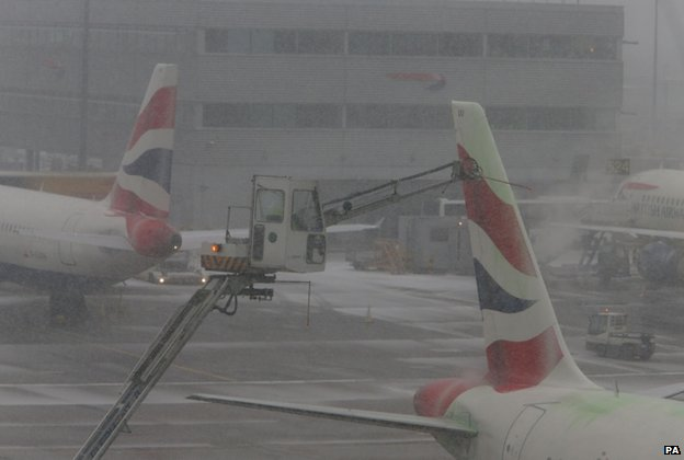 Planes being de-iced at Heathrow