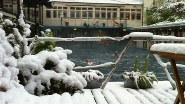 Swimming Pool (and swimmers) surrounded by snow
