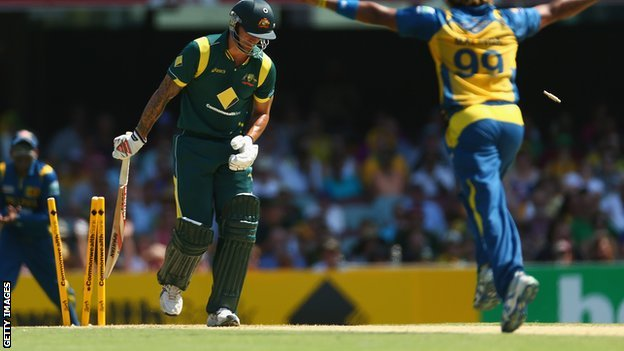 Mitchell Johnson is bowled by Lasith Malinga