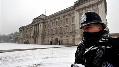A Metropolitan Police officer on duty outside Buckingham Palace in central London,