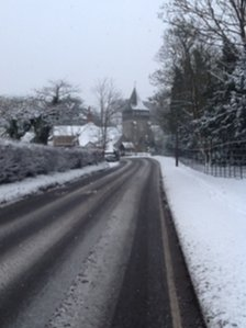 Picture of snowy road in Surrey