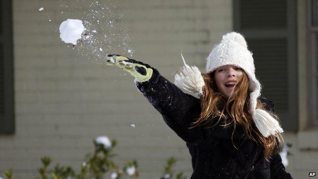 Girl throws snowball