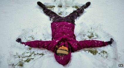 Woman doing snow angel
