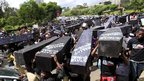 Kenyan protesters in Nairobi carrying mock coffins - Wednesday 16 January 2013