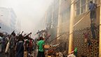 People trying to get into the burnt out building of Lome's main market in Togo - Saturday 13 January 2013