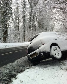 A car affected by snow on the B4070 in Gloucester