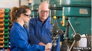 Apprentice and trainer operate machine