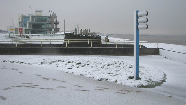 Footprints are seen in the snow in Llanelli