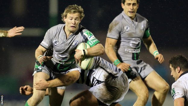 Connacht scrum-half Kieran Marmion is tackled in the Heineken Cup game