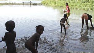 Children by the river near Lampsar, Senegal