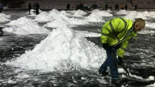 Man clearing snow on pitch