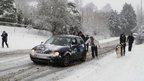 People pushing a car. Photo: John Wilkes