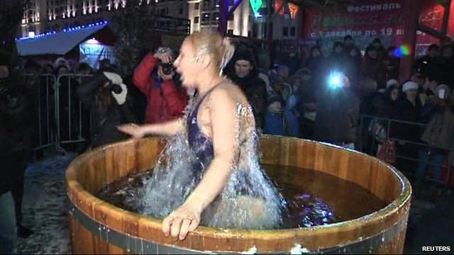 Woman jumps into ice water in barrel