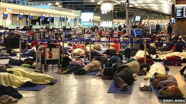 People sleeping on the floor at Heathrow