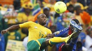 """Cape Verde""""s Toni Varela (R) challenges South Africa""""s Bernard Parker (L)"""