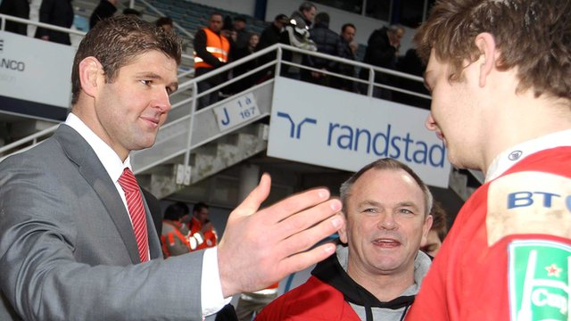 Johann Muller and Mark Anscombe congratulate Iain Henderson's after Ulster's win in France