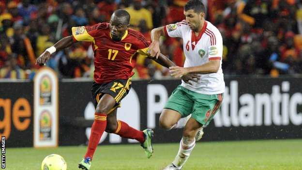 Morocco's midfielder Adil Hermach (R) challenges Angola's forward Mateu