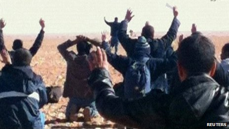 Hostages are seen with their hands in the air at the In Amenas gas facility in this still image taken from video footage taken on 16 or 17 January 2013