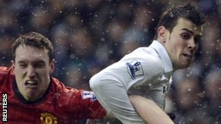 Phil Jones kept a close eye on Tottenham's Gareth Bale