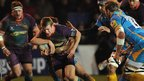 Newport Gwent Dragons scrum-half Jonathan Evans takes on London Wasps