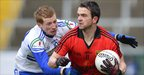 Mark Poland shields the ball from Kieran Hughes during Monaghan&#039;s victory over Down