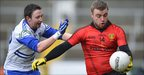 Arthur McConville of Monaghan and Down&#039;s Owen Duffy in action at the Athletic Grounds in Armagh