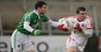 Fermanagh&#039;s Ryan McCluskey closes in on Conor McAlliskey during the second semi-final at Armagh