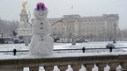 Snowman outside Buckingham Palace