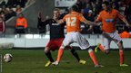 Cardiff's Joe Mason is fouled by Blackpool's Kirk Broadfoot during the Championship's late kick-off at Bloomfield Road.