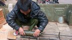 Kachin KIA Soldier With Unexploded Bomb from Burmese Aircraft