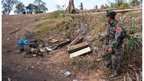 Kachin soldier with bodies of two comrades killed in airstrike