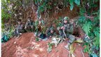 Kachin rebel soldiers in a jungle foxhole.