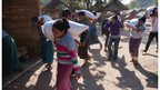 Displaced Kachins unloading rice at the camp near Laiza.