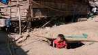 Child in bomb bunker at a camp for displaced people.