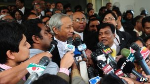 Bangladeshi Attorney General Mahbubey Alam talk to journalists following the verdict at the International Crimes Tribunal court premises in Dhaka on January 21, 2013.
