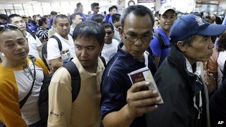Filipinos evacuated from the crisis-hit Algerian gas plant arrive back home at Manila international airport