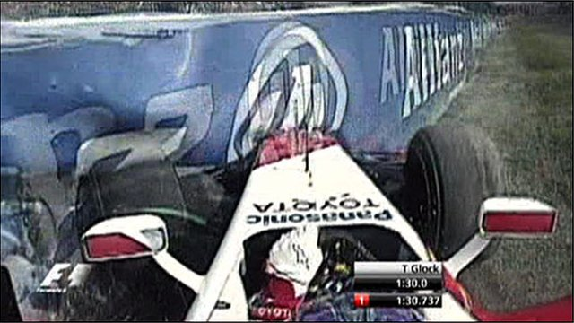 Timo Glock hits the tyre wall