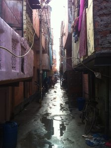 The narrow wet and muddy lane where the victims&#039; family live in Delhi