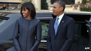 US President Barack Obama and First Lady Michelle Obama arrive at St John's Church in Washington DC on Monday