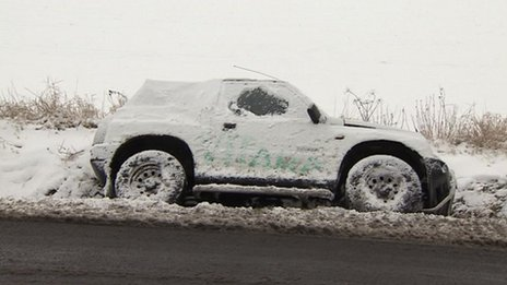 A 4x4 in a ditch in the snow in St Neots, Cambridgeshire