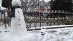 Snowman and snowdog
