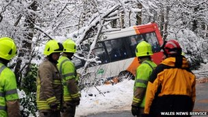 Three children suffered minor injuries after a bus slid off a road at Abercarn, Caerphilly county on Monday