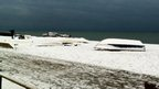 Snow covered fishing boats on Seaford beach