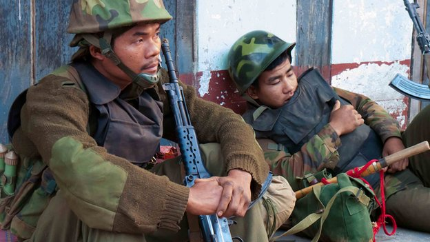 Kachin rebel soldiers return exhausted from the front line