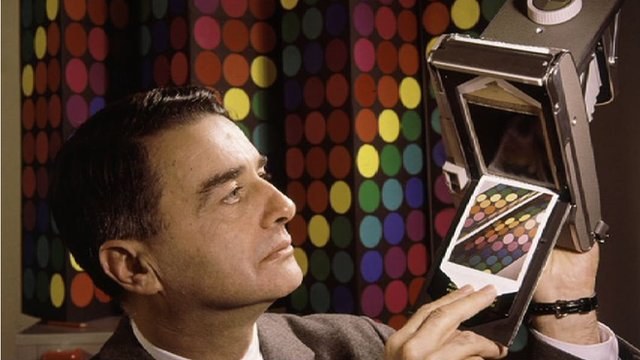 Edwin Land with a Polaroid camera