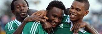 Jon Obi Mikel (centre) celebrates scoring for Nigeria