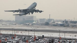 Flight taking off in snow at Heathrow