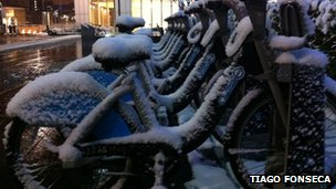Boris Bikes covered in snow.