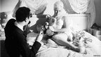 Michael Winner and Diana Dors on the set of West 11