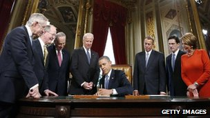 President Barack Obama is flanked by congressional leaders 21 January 2013